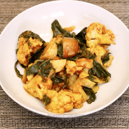 Curried Cauliflower + Potatoes, Kale, Sweet Potato Greens and Tomatoes