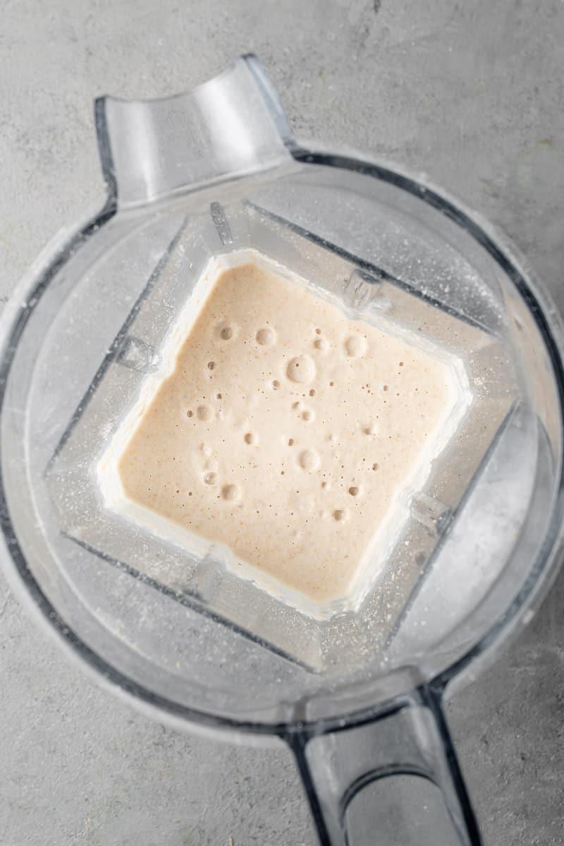 a blender filled with vegan pancake batter