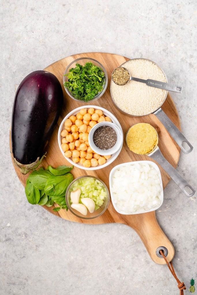 Ingredients for vegan eggplant meatballs on a wooden board by sweetsimplevegan
