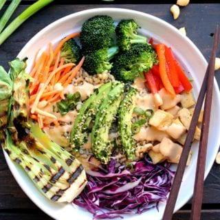Asian Inspired Buddha Bowl with Spicy Peanut Sauce {oil-free} + 3 Tips for Going Vegan