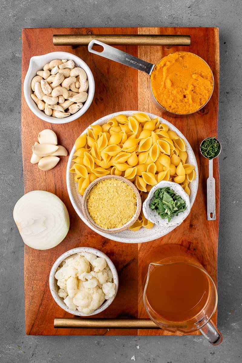 Ingredients for Vegan Pumpkin Pasta on a Wooden Board