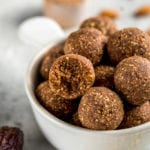 These are the perfect healthy snack! These chocolate protein bliss balls are easy-to-make, delicious AND vegan! #plantbased #protein #veganprotein #snackidea #easysnack #healthysnack #kids #chocolate #nuts #proteinpowder