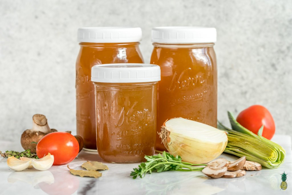 No need to buy vegetable broth from the store ever again! This step-by-step guide to making it at home is easy, cheap AND low-sodium! #homemade #vegetablebroth #vegetablestock #zerowaste #budget #lowsodium #healthy #vegan #oilfree #hack #diy