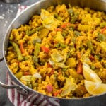 MUST TRY Loaded Vegan Paella! Super fulling, easy to make AND loaded with vegetables! #vegetable #loaded #paella #vegan #veganpaella #entree #veganentree #dinner #vegandinner #veganlunch #easyvegan #healthyvegan