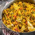 MUST TRY Loaded Vegan Paella! Super fulling, easy to make AND loaded with vegetables! #vegetable #loaded #paella #vegan #veganpaella #entree #veganentree #dinner #vegandinner #veganlunch #easyvegan #healthyvegan