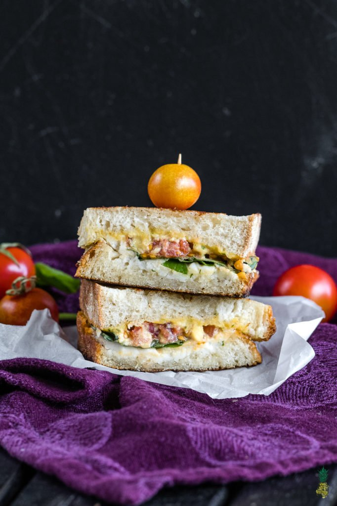 Grilled cheese brought to a whole new level! This vegan caprese grilled cheese will satisfy anyone, vegan or not! It is easy to make, decadent and so dang good! #vegan #caprese #grilledcheese #sandwich #entree #lunch #dinner #vegansandwich #bestvegan #veganized #italian