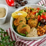 The best buddha bowl rendition yet! This Vegan Mediterranean Buddha Bowl is hearty, nutritionally dense, jam packed with flavor and easy to make! #Vegan #Mediterranean #Buddha #Bowl #entree #veganbowl #easy #lunch #work #onthego #budget #musttry #fresh #falafel #chickpeas #hummus #homemade