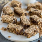 The perfect on the go snack or breakfast that is perfect for meal prep! With these vegan chocolate chip protein cookie bars, you won't have to buy protein bars at the store ever again! These are sweet, chewy, chocolatey and packed with healthy plant-based protein. #vegan #protein #plantbased #vanilla #proteinpowder #snack #mealprep #breakfast #oilfree #glutenfree #musttry #homemadeproteinbar #proteinbars #gym #workout #postworkout #healthysnack