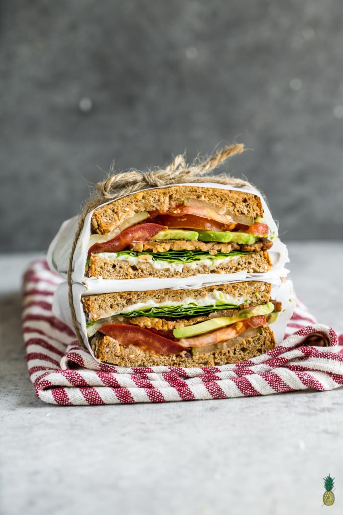The viral TTLA sandwich from Whole Foods just made its way into your kitchen. Learn how to make this delicious vegan recipe from scratch, loaded with tempeh bacon, tomatoes, lettuce, avocado and a homemade garlic aioli. Get ready to dig into your new favorite sandwich!#vegan #sandwich #ttla #homemade #wholefoods #easyrecipe #healthyrecipe #veganlunch #veganentree #vegansandwich #restaurantstyle