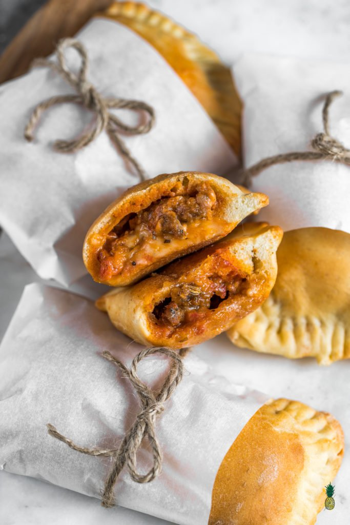 A veganized version of a popular frozen dish, minus all the weird stuff. You really only need FOUR ingredients for this recipe—store-bought dough, meatballs, mozzarella cheese and marinara sauce. These are perfect for school or work, kids will love them AND they will take you right back to your childhood. #vegan #hotpockets #homemade #healthier #easy #4ingredients #fooldproof #kids #vegankids #veganschool #veganlunchbox #workmeal #lunchbox #childhood
