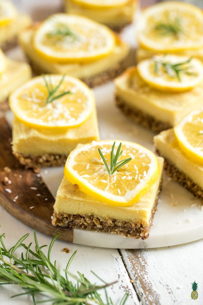 macro image of spring desserts topped with a lemon slice and rosemary.