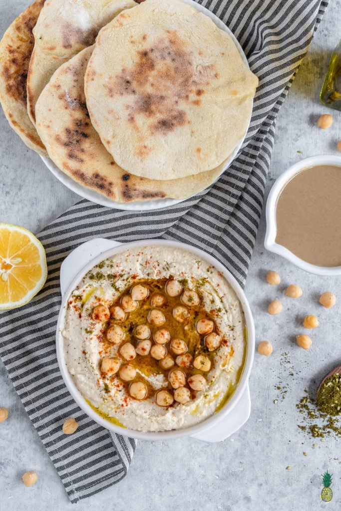 Learn how to make the BEST hummus at home. It is SO easy to make and is better than anything you can find in stores. With just a few simple ingredients and a little bit of patience, you'll be well on your way to a party in your mouth! #hummus #homemade #snack #side #kids #lunch #onthego #healthy #oilfree #musttry #vegan #mediterranean #fresh