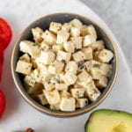 An easy and delicious vegan feta cheese that is made out of tofu and will make all of your dreams come true. This cheese swaps perfectly with its nonvegan counterpart and the possibilities for serving it are endless! #vegan #vegancheese #feta #easy #foolproof #salad #appetizer #side #avocadotoast #veganpasta #veganized #musttry