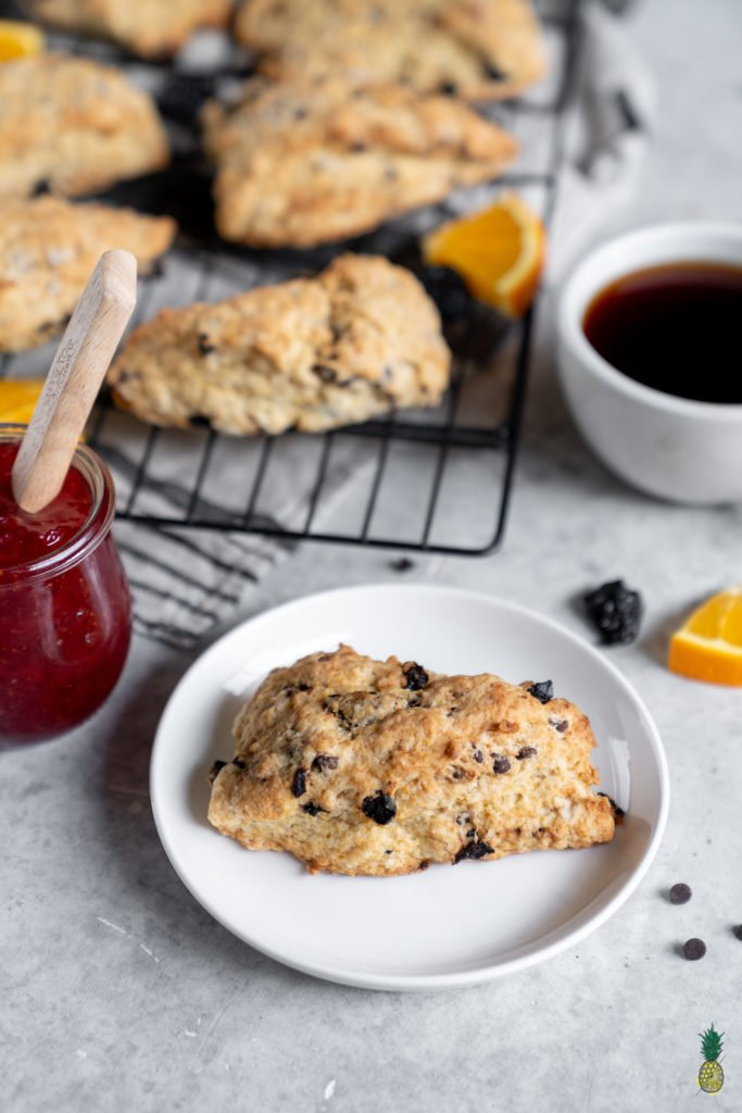 Easy-to-make chocolate cherry scones that are ready in under an hour and require just 10-ingredients. These make for the perfect breakfast, afternoon snack alongside some tea or even dessert with a dollop of vegan whipped cream! #chocolate #cherry #scones #breakfast #snack #teatime #pastry #vegan #coconutoil #CBD #bestvegan #easysnack #10ingredient #underanhour
