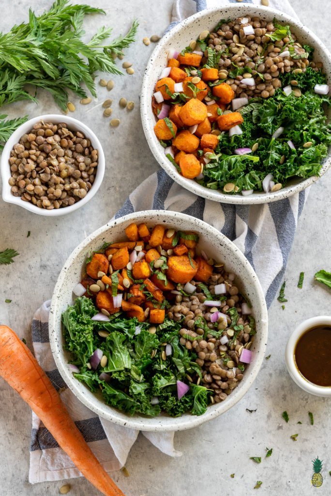 A healthy, filling and flavor-packed meal that is perfect for lunch or dinner and is great to take on the go. Filled with tender cumin roasted carrots, lentils, a garam masala-infused vinaigrette, mint, greens and more! #garammasala #greens #lentils #proteinpacked #veganprotein #easyvegan #onthego #lunch #bentobox #underanhour #foolproof #weeknight #leftovers