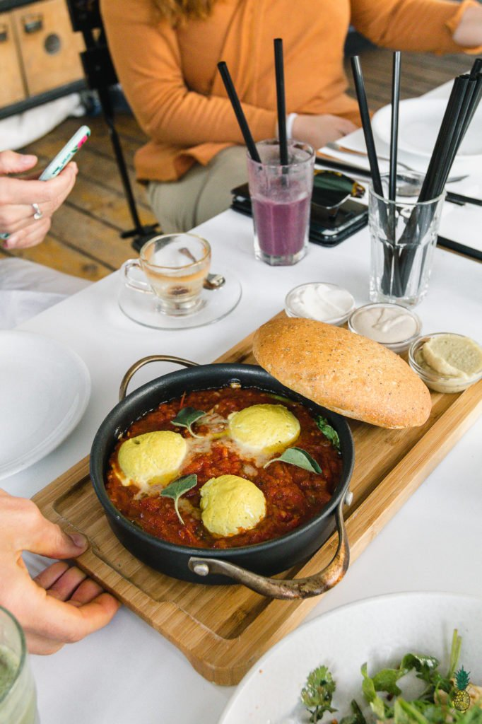 If you haven't had shakshuka before, you are in for a treat! This dish is loaded with a plethora of vegetables in a thick tomato sauce, topped with a flavor-packed tofu scramble, and ready in less than 30 minutes! #shakshuka #breakfast #lunch #dinner #tunisia #middleeastern #northafrica #israel #shakshouka #veganized #egg #tofuscramble #healthy #lowfat #30minute #meal #easy #sweetsimplevegan #entree #onthego #togo