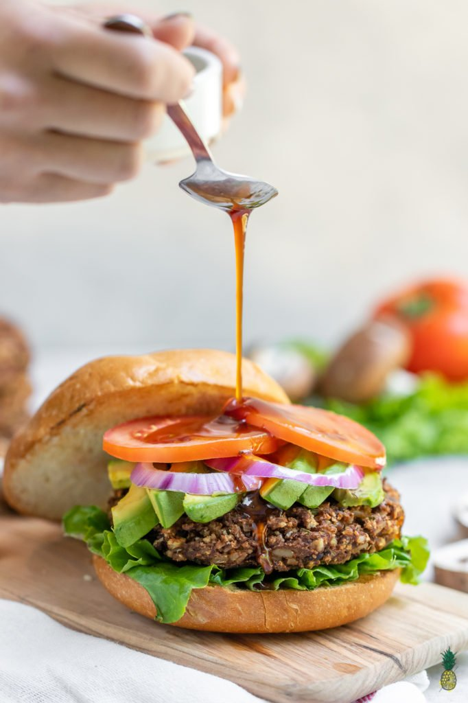 These vegan burgers are easy to make, require simple ingredients and is jam-packed with plant protein. Plus, they are bursting with flavor and are perfect for your next summer party. #veggie #burger #vegan #easy #veganprotein #plantprotein #vegansummer #summerrecipe #party #vegankids #sweetsimplevegan #lunch #dinner #entree