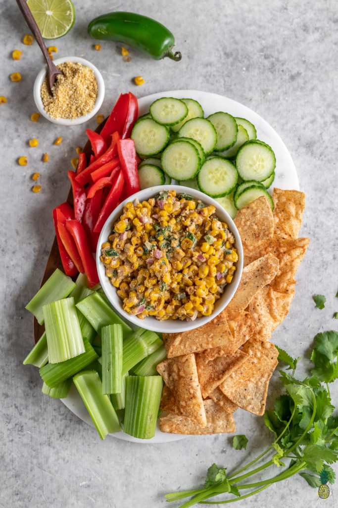An easy and flavor-packed Mexican street corn inspired dip that is ready in just 15-minutes. This recipe is loaded with corn, jalapeños, red onions and more, and will definitely be a hit at your next gathering! #mexican #streetcorn #dip #vegandip #vegan #elote #musttry #veganparty #holiday #easy #15minutes #nofuss #snack #side #appetizer