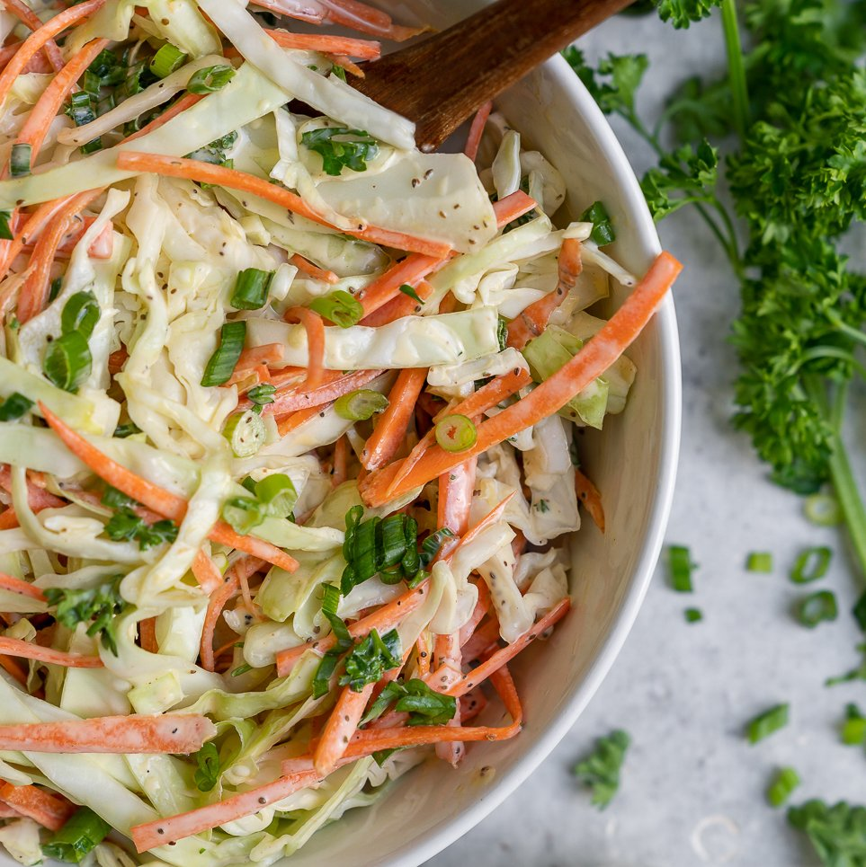 A quick & easy vegan coleslaw recipe just like what we remember digging into growing up. It's creamy and crunchy with the perfect amount of bite, plus it only takes 10 minutes to make! #thebest #vegan #coleslaw #summer #recipe #side #appetizer #pulledjackfruit #barbecue #sandwiches #salad #veganparty #lastminuterecipe #quickrecipe #easyvegan #sweetsimplevegan