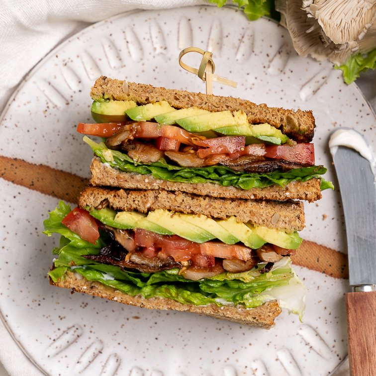 Behold your new favorite sandwich—a quick and easy oyster mushroom sandwich made in just 15 minutes that is packed with flavor and easy to take on the go! #MLTA #BLTA #Vegansandwich #easymeal #lazymeal #veganized #impressivelunch #onthego #musttry #lastminute #partymeal #kidslunch #summer #sweetsimplevegan