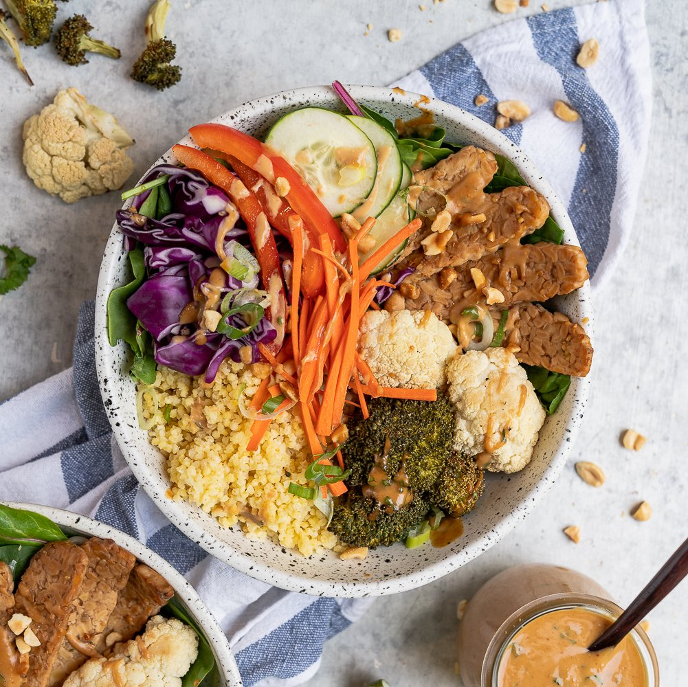 These Thai peanut grain bowls are easy to make and are perfect for an on the go lunch or dinner! Peanut Sauce,roasted veggies, tempeh, and millet, it will keep you full and fueled for the day. Plus, they are vegan and can easily be made gluten-free. #vegan #glutenfree #backtoschool #grainbowl #millet #lunch #entree #kids #protein #tempeh #easy #mealprep #easyvegan #healthy
