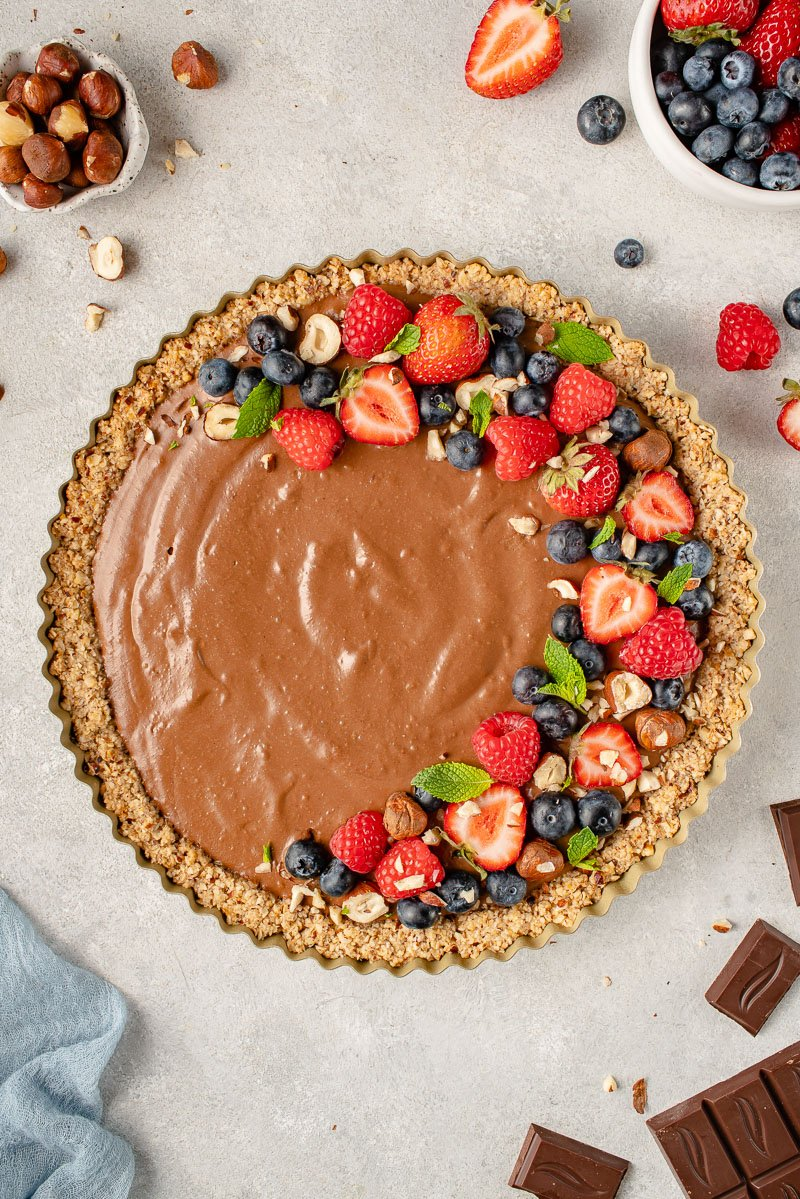 overhead image of mousse tart with fruit on top