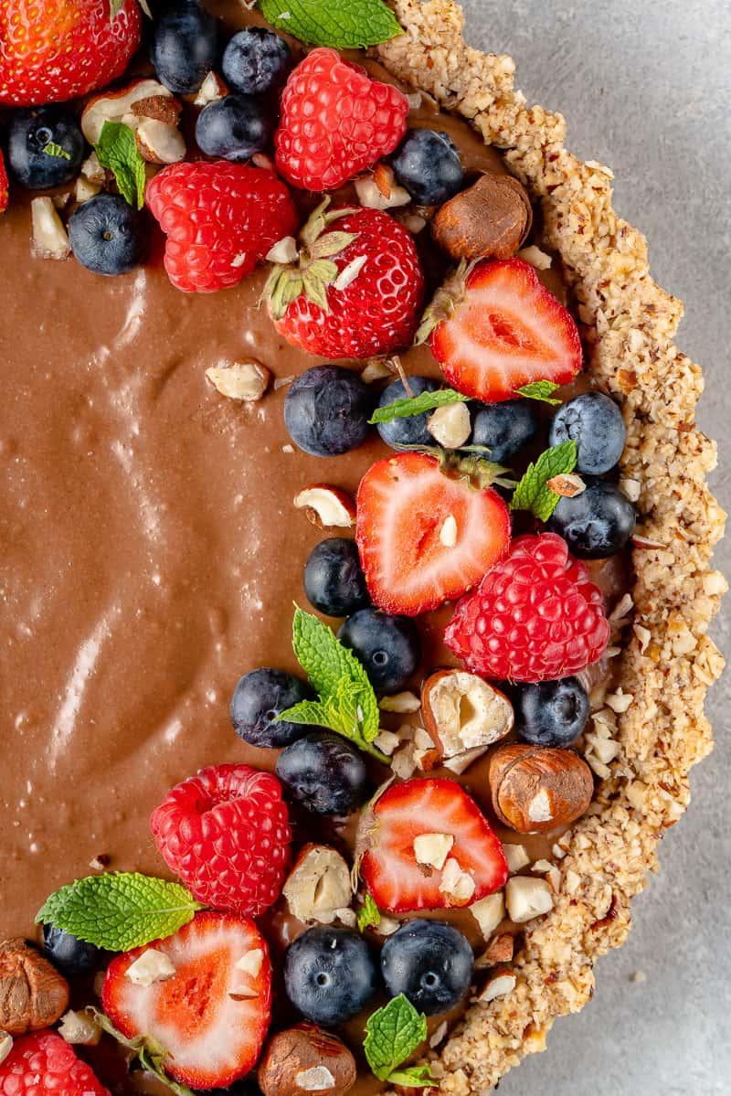 macro overhead image of mousse tart with fruit on top