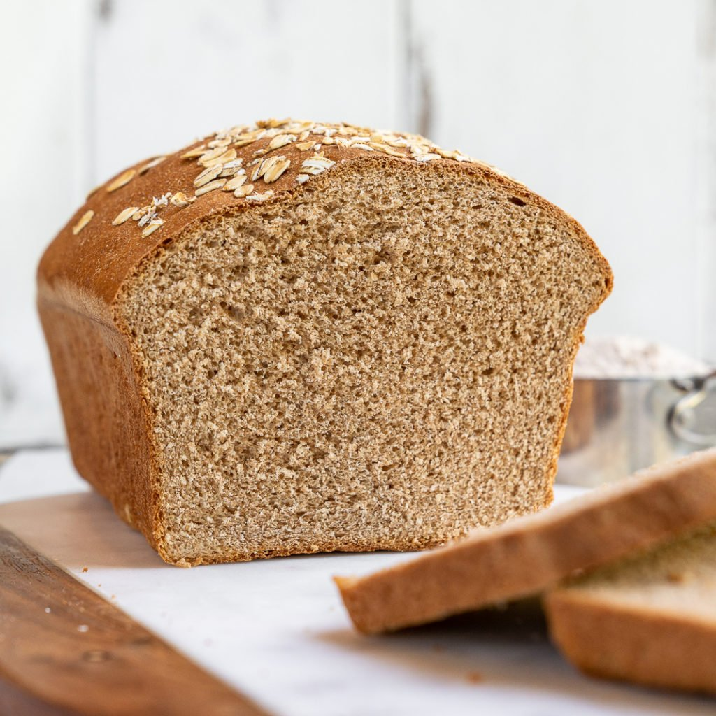 A simple and delicious recipe for the perfect homemade 100% whole wheat bread loaf. It's great for sandwiches, toast, and beyond! #homemade #wholewheat #bread #loaf #sandwich #backtoschool #kids #savemoney #budget #easy #wholegrain