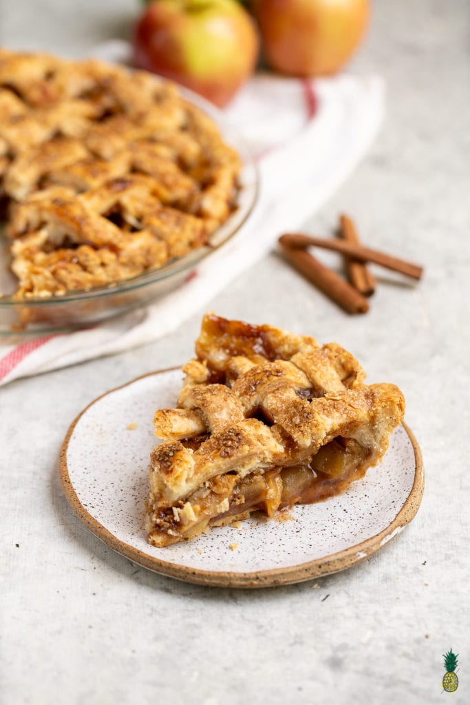 A classic holiday dessert, made vegan! This recipeis perfect for fall, easy to make and damn delicious. Instead of vegan butter, the crust is made by using coconut oil, which results in a perfectly flaky pie crust to surround the sweet and juicy apple filling. Get ready to fall in love with this vegan dessert!#fall #dessert #coconutoil #vegan #crust #applepie #easydessert #falldessert #musttry #veganpie #veganfall #side #party #holiday