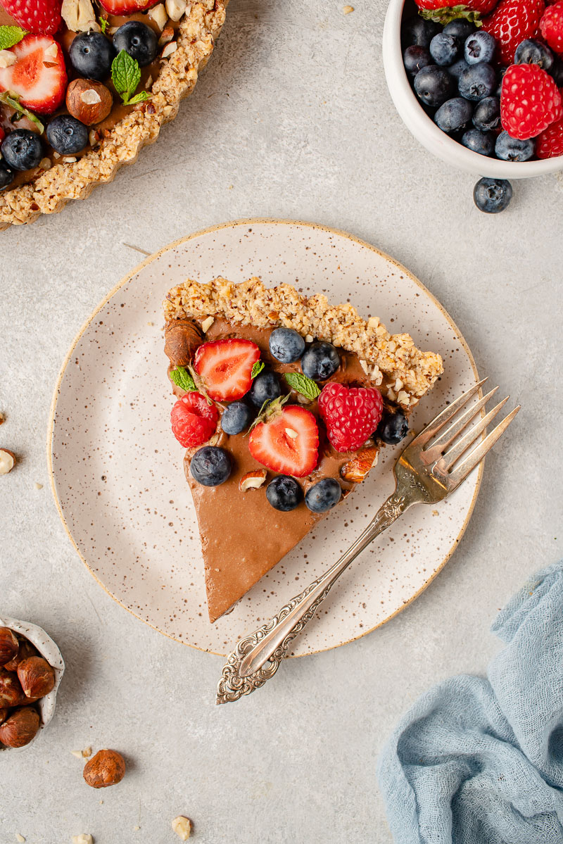 overhead image of pumpkin chocolate mousse tart slice