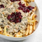 A great way to use up Thanksgiving leftovers that is simple and easy to make. This poutine is delicious and a great way to change things up if you are bored of plain ol' leftovers. Plus, it's vegan! #vegan #thanksgiving #leftovers #musttry #kidfriendly #easy #stuffing #gravy #veganroast #homemadefried #cranberrysauce #veganthanksgiving #poutine