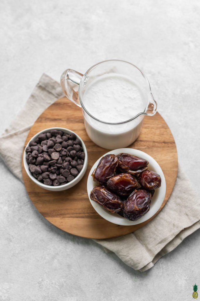 Coconut milk, chocolate chips and medjool dates; ingredients for vegan chocolate mousse