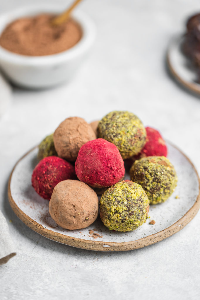 Colorful vegan truffles on a serving plate