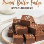 Chocolate peanut butter fudge stacked up on a plate