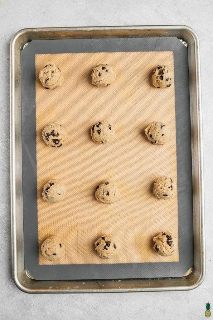 Vegan chocolate chip cookie dough on a baking sheet