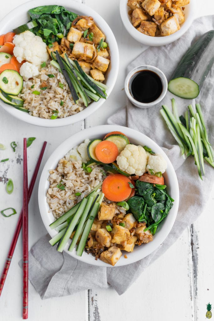 Lemongrass tofu in buddha bowls with steamed vegetables and fried rice