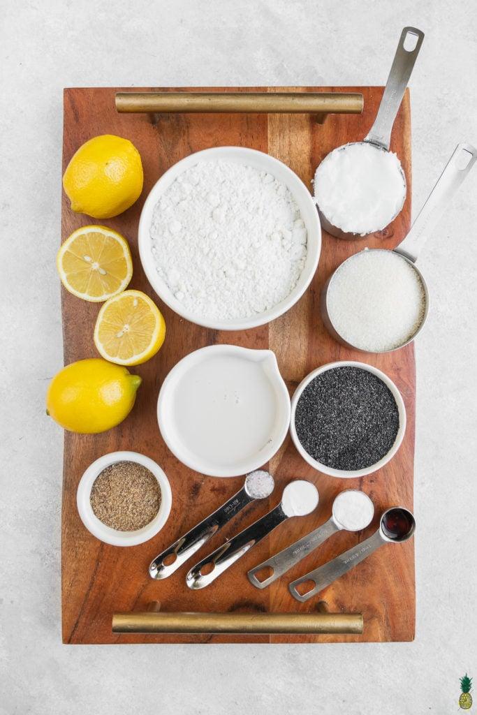 Ingredients in cups for gluten-free lemon poppyseed loaf