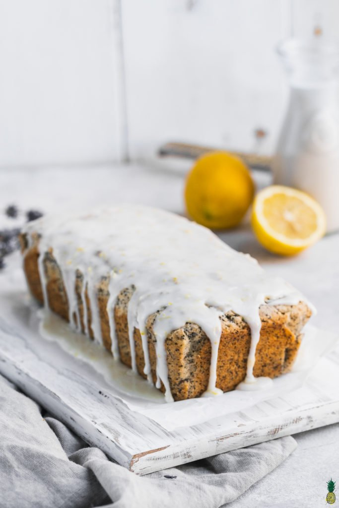 Gluten-free vegan lemon poppyseed loaf with a glaze dripping down the sides