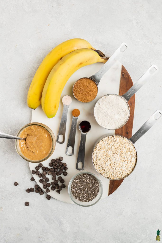 Ingredients to make oatmeal breakfast bars on a marble platter