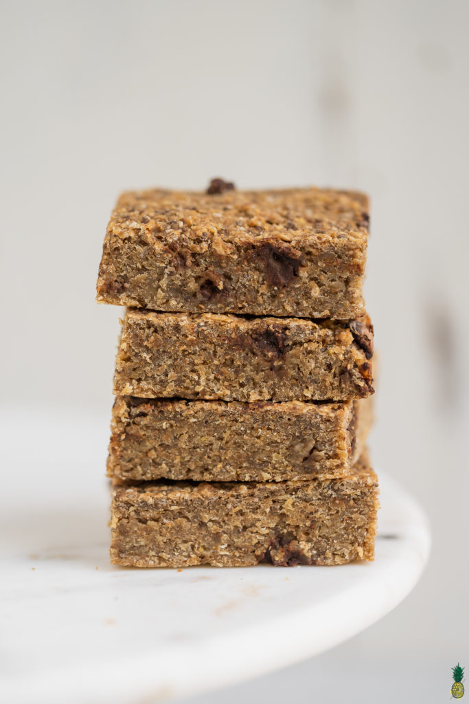stacked up healthy Oatmeal breakfast bars on white marble.