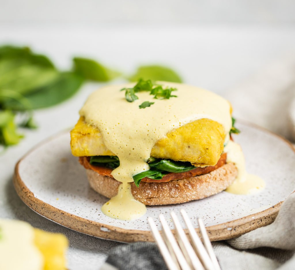 A close up shot of Vegan Eggs Benedict with Hollandaise