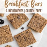 Oatmeal breakfast bars on white marble with berries