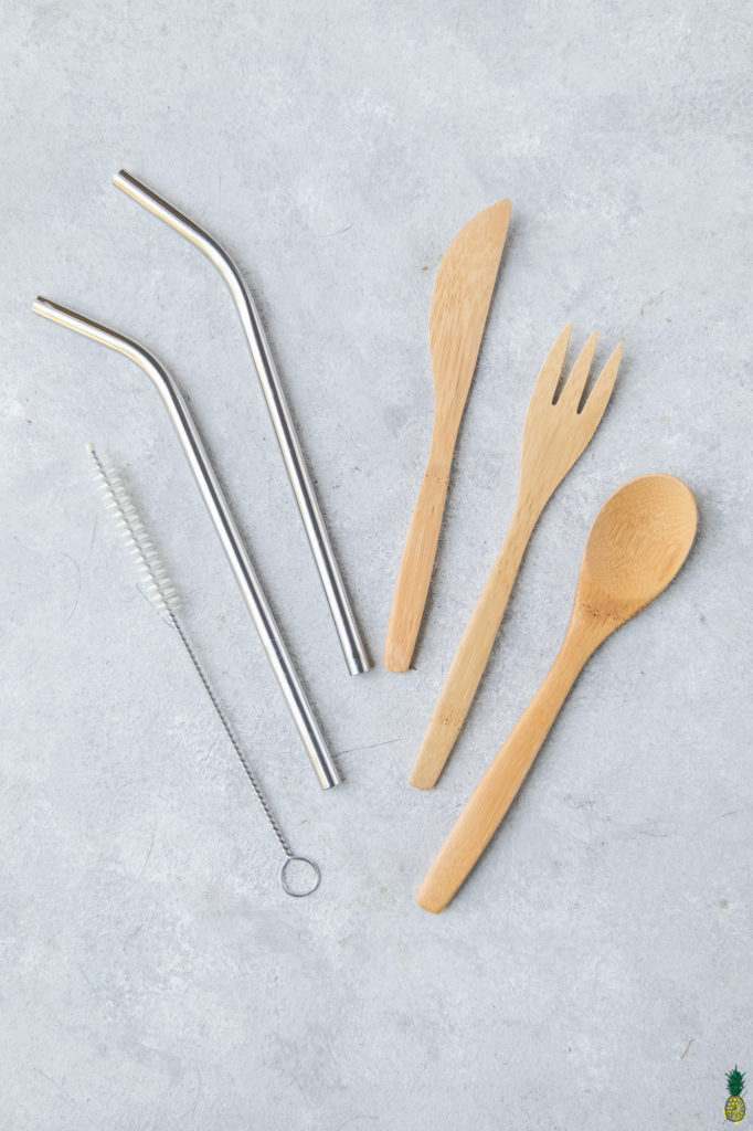 overhead photo of reusable straws and utensils