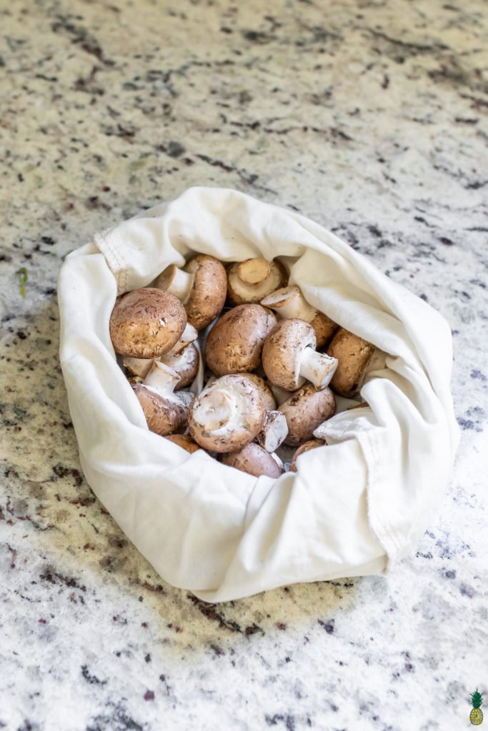 brown mushrooms in a cloth bag for the refrigerator