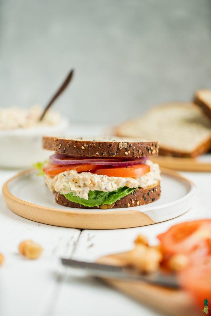 Vegan chickpea salad sandwich on a ceramic plate. Sweet Simple Vegan Blog