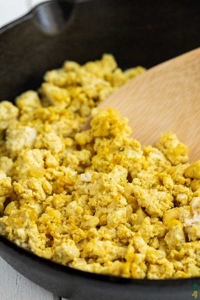 Close Up of vegan tofu scramble in a cast iron skillet - 6-ingredient recipe by Sweet Simple Vegan.