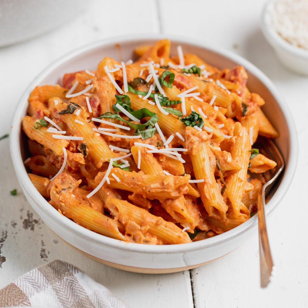 featured image for vegan penne alla vodka in a bowl with a fork by sweet simple vegan