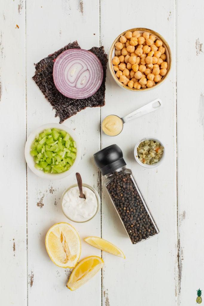 Ingredients to make vegan tuna salad sandwiches on a wooden board. Sweet Simple Vegan Blog