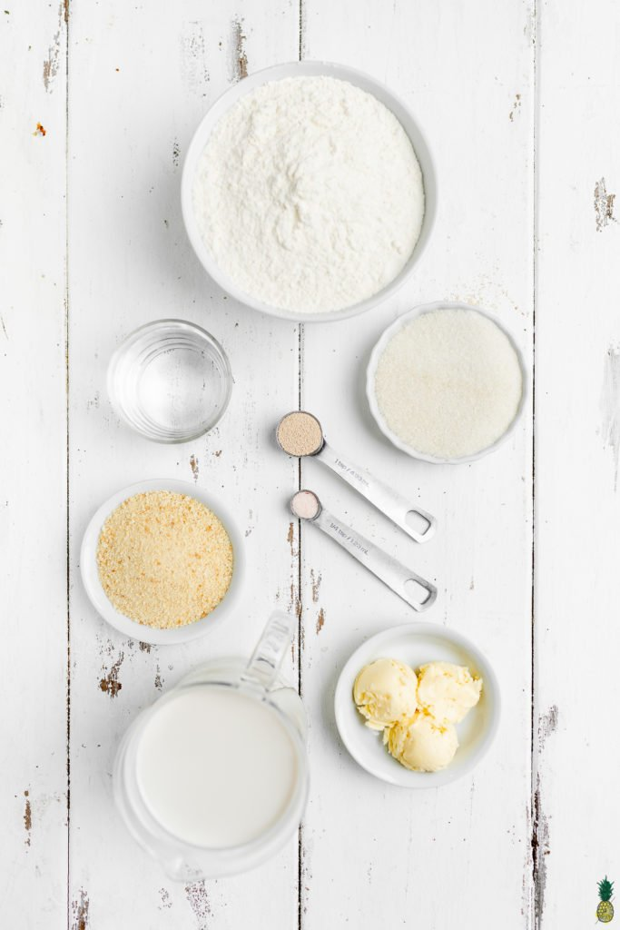 Ingredients for vegan pandesal on a wooden photography board by Sweet Simple Vegan