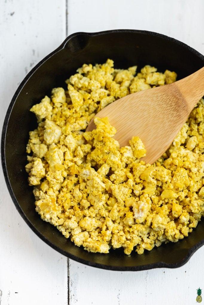 Perfect vegan tofu scramble in a cast iron skillet by Sweet Simple Vegan Blog.